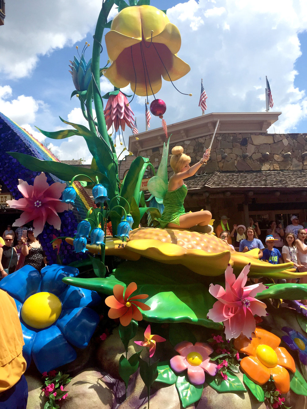 Tinkerbell sits on the tail end of the float. I love that they surrounded her with giant flowers, so you get a sense of her true size as a fairy.