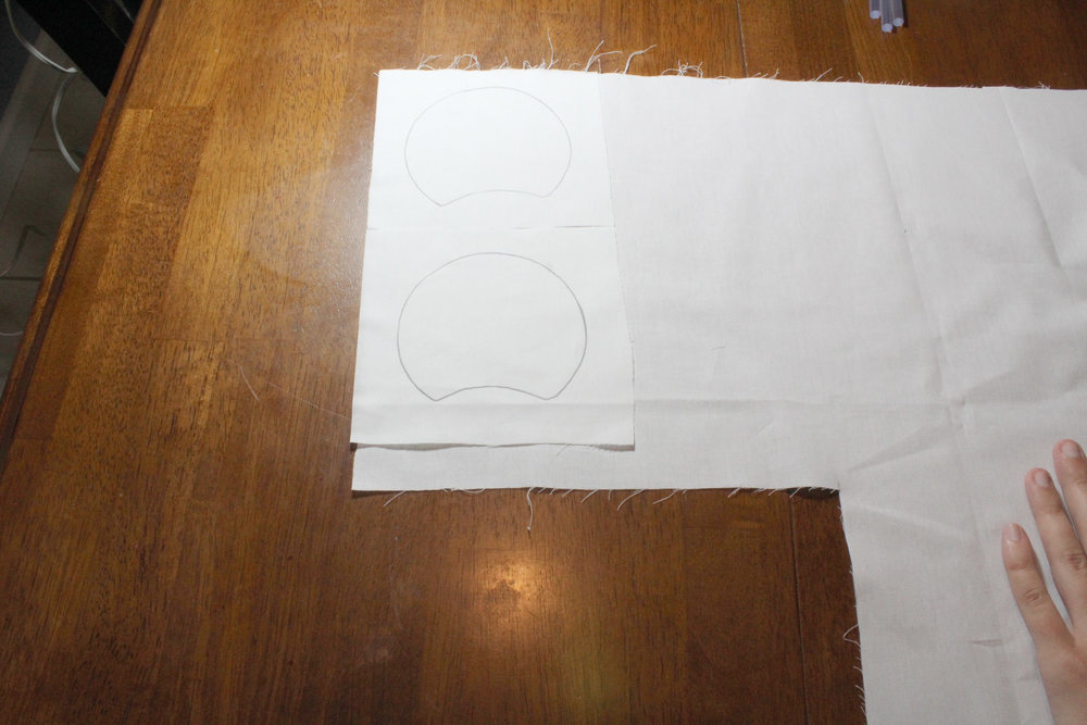 Here I've placed the two square pieces that I've just cut back onto my fabric, and I'm going to use them as templates to cut two more identical pieces for the backs of my ears.
