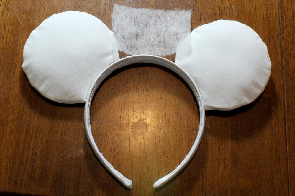 This is how large my rectangle of batting was, compared to my Mickey Ears. Always remember that your final bow will be slightly larger than this rectangle of batting.