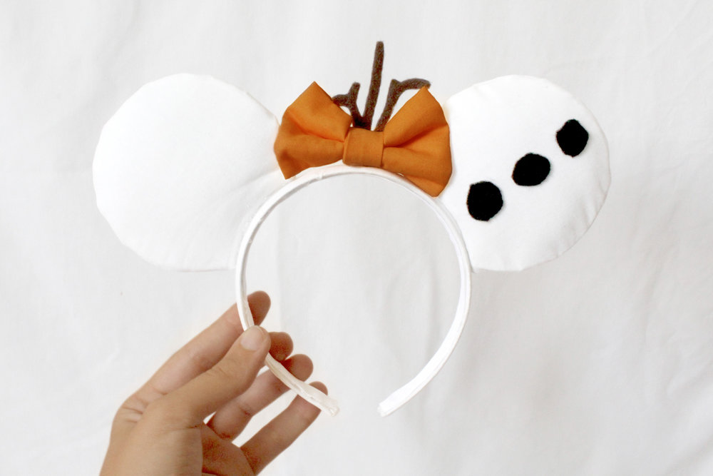I made this pair into Olaf themed ears using black and brown felt details.