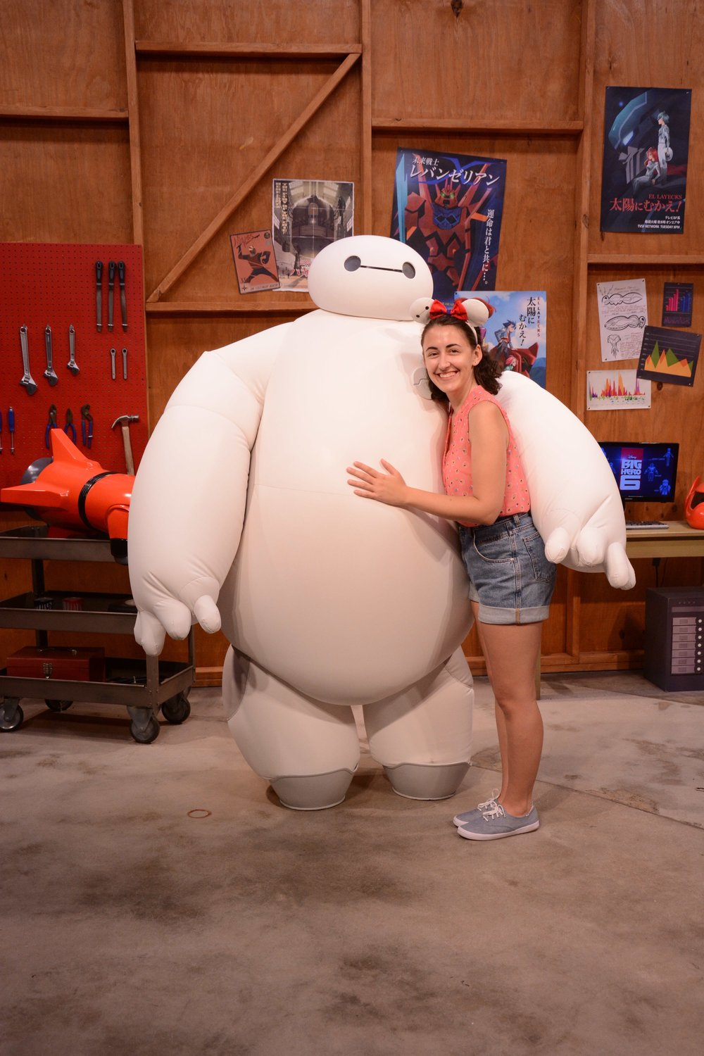 Another great part of the character meet and greet spots are the rooms that the characters are in. For example, Baymax is in Hero's workshop. They really make great backdrops for your photos!