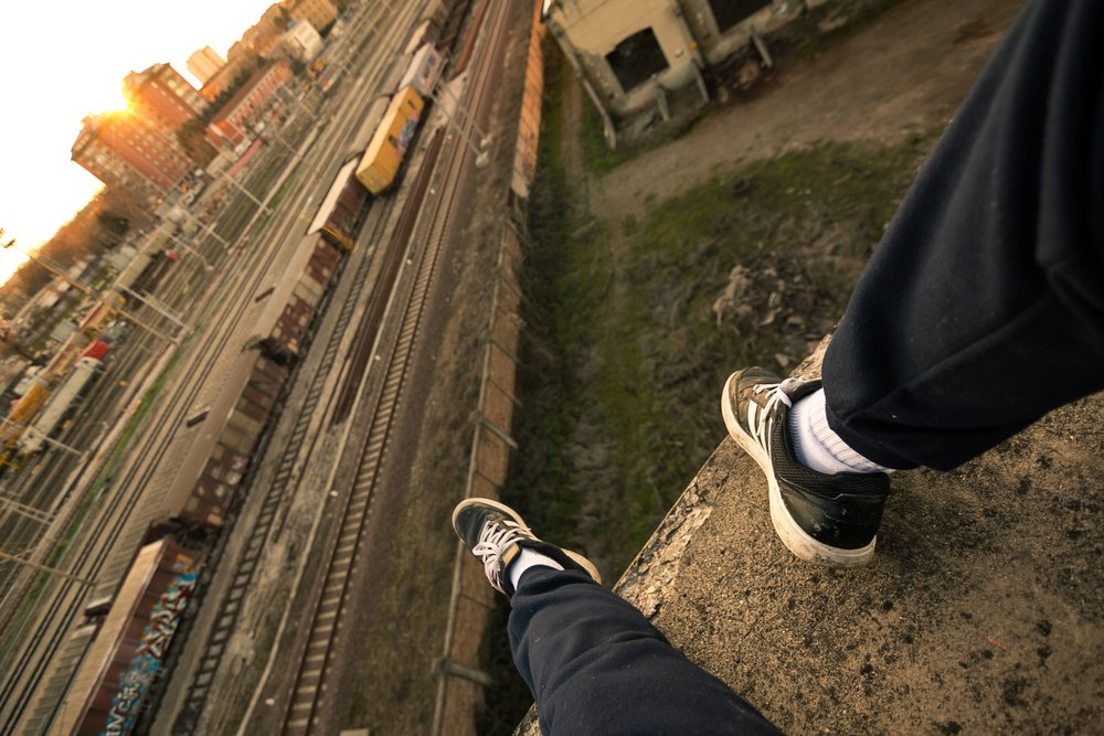 It would be so easy....  - Who is this perched above a rail yard? The shoes and posture suggest someone young. Is it a boy? A girl? Where is he coming from? Going to? What is her situation? And exactly what is it that would be so easy? In their stories, our authors offered intriguing answers to these and other questions inspired by the Contest 3 prompt.
