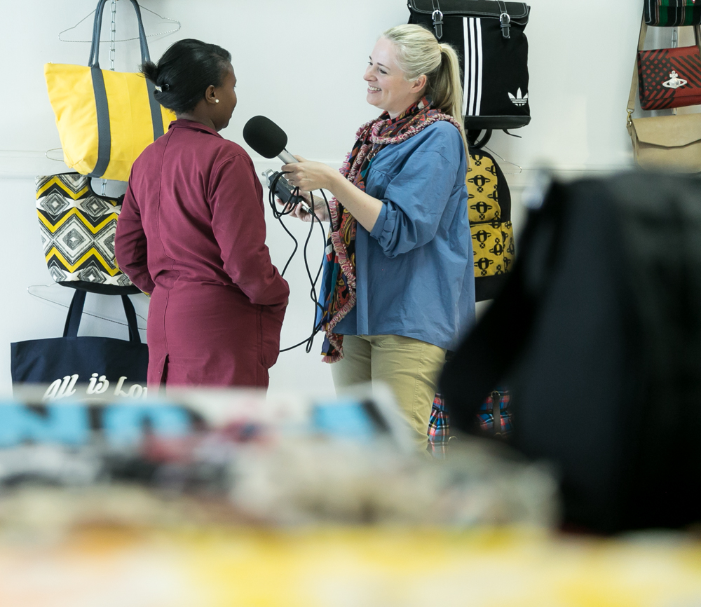 Clare interviewing Joan, a quality controller at the Athi River factory. Photographed by Chris Wanga