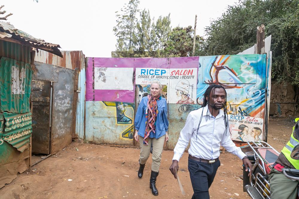 Clare leaving the EFI hub in Korogocho with master beader Ibrahim. Photograph by Chris Wanga