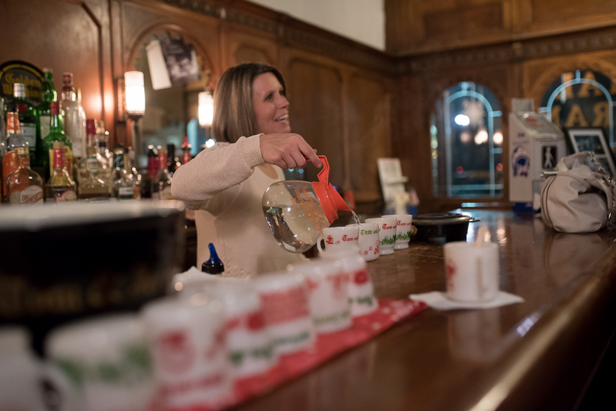Owner Libby Dephtereos warms the mugs with hot water before assembling the Tom and Jerry cocktails!