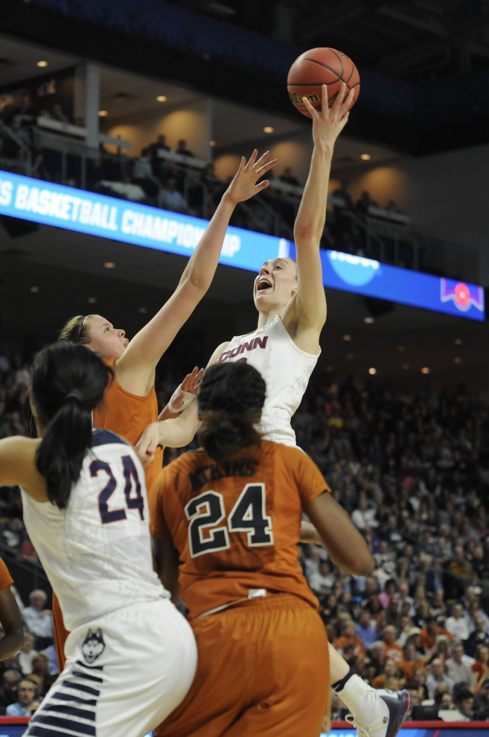 Connecticut forward Breanna Stewart (30) goes for a rebound during an NCAA tournament quarterfinal game against Texas on March 28, 2016. Stewart finished with 21 points, 13 rebounds,  5 assists, 3 blocks, and 3 steals in UConn's 86-65 win.