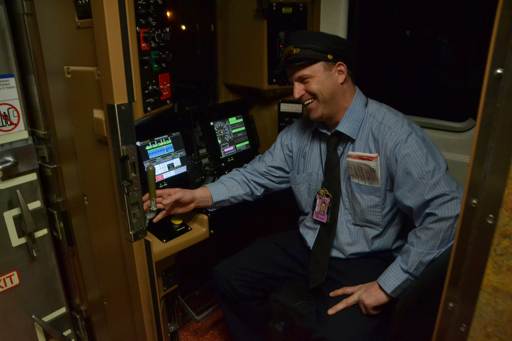 Justin Shepard, train conductor for Metro North, smiles to a coworker on Feb. 2, 2016. As train conductor, Shepard can be called in to work long shifts with no regular schedule.