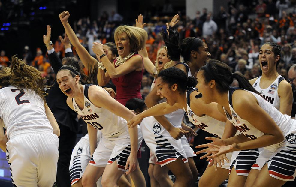 The UConn bench explodes with joy following Briana Pulido jumpshot in the final minute of UConn's 82-51 victory over Syracuse in the NCAA championship game at Bankers Life Fieldhouse in Indianapolis, Ind. on Tuesday April 5, 2016. Pulido, a senior, will graduate with three national championships.