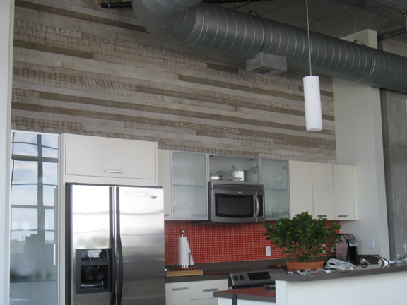 Whitewashed and mixed barnwood paneling in a residential kitchen