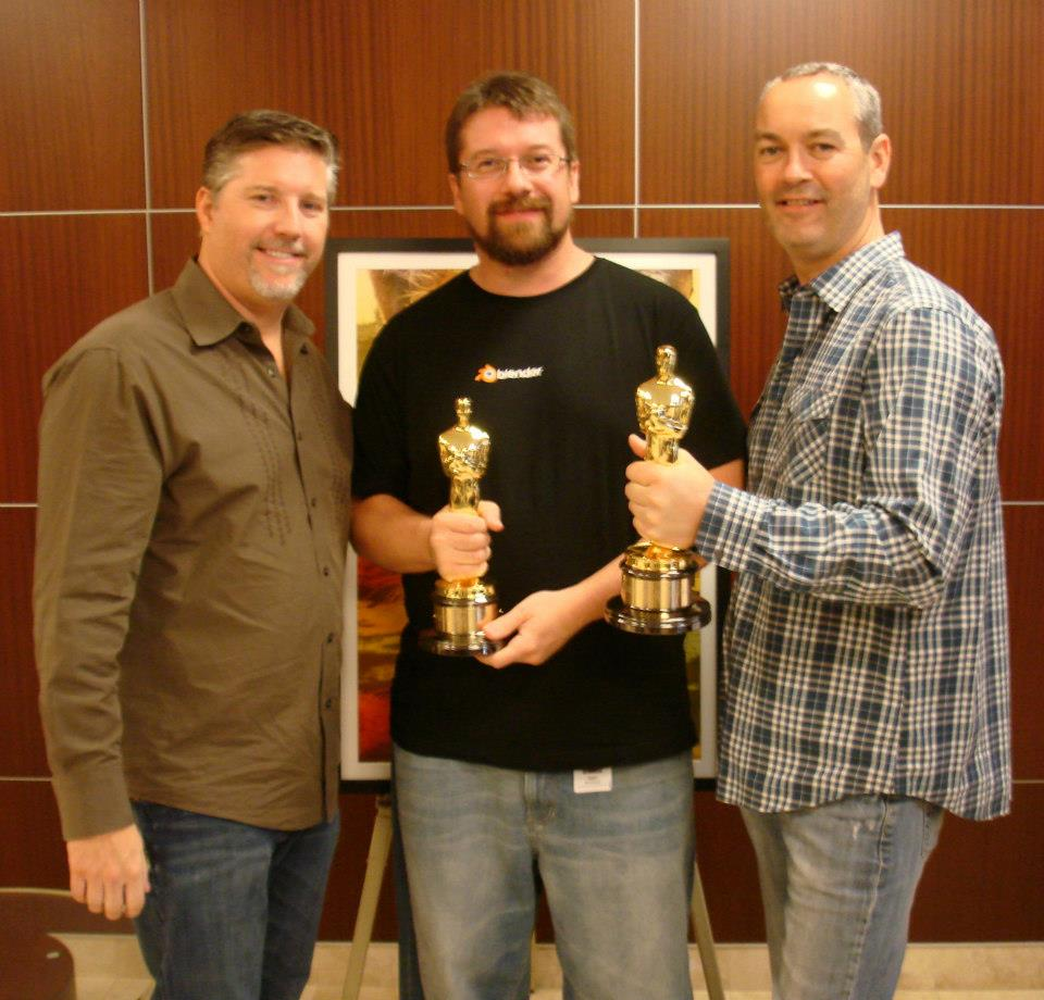 Sean Kennedy (guy in the middle), holding the Oscar from Life of Pi.