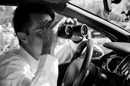 Decker conducts surveillance with binoculars
