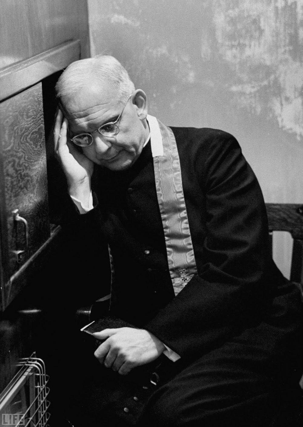 Father Scarpino hears confession