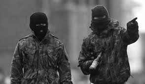 Irish Republican Army soldiers in balaclavas