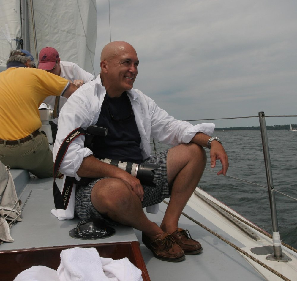 David Liscio photog bio image with camera on boat .jpg