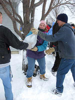 Sandbagging around Moorhead homes along the Red River in 2009.