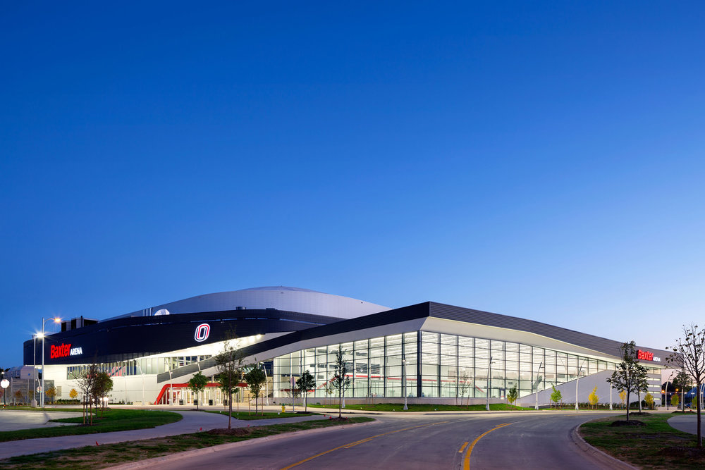 Baxter Arena opened to the public in October 2015, the end product of a joint community/university partnership led by Heritage Services of Omaha which raised $90 million for its construction and additional infrastructure improvements. The arena is a vibrant community asset, serving as the home of University of Nebraska Omaha hockey, men's and women's basketball and volleyball as well as concerts, civic events, campus recreation, youth hockey, figure skating and curling. The building seats 7,500 with additional space for standing room.