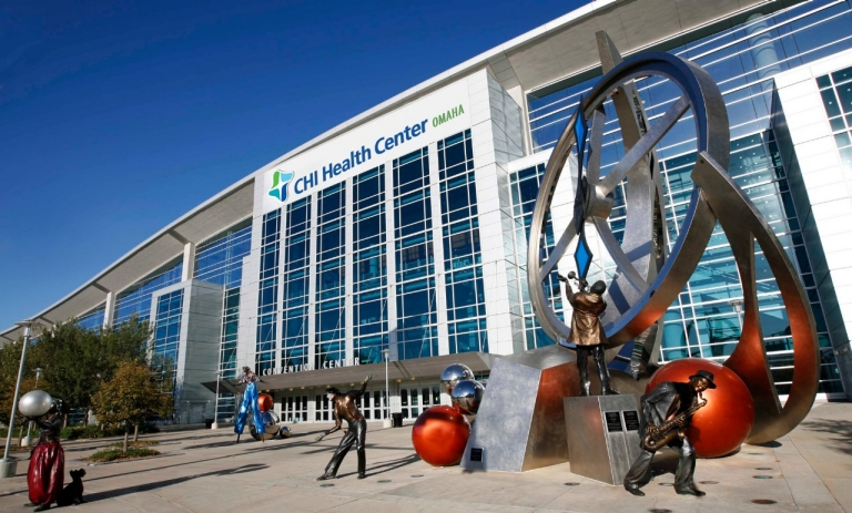 CHI Health Center Omaha  (formally CenturyLink Center) spans 422 acres, which is approximately 100 city blocks. The facility opened in September 2003 and contains more than 1,100,000 square feet, including a 194,000 square foot exhibition hall, more than 63,000 square feet of meeting space and an 18,300 seat arena. The site includes approximately 4,500 parking spaces, including a 3-story, 500 stall parking garage attached to the arena portion of the facility. The facility is connected via skywalk to the 450 room Hilton Omaha. CHI Health Center Omaha is home to the Creighton University Men's Basketball Team.