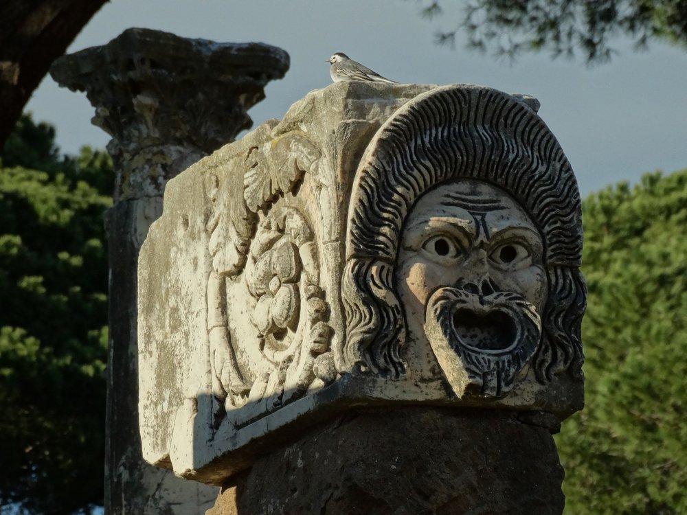 Theater Mask column in Ostia Antica