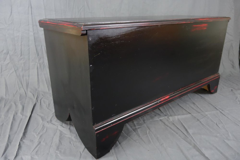 Black over red blanket chest