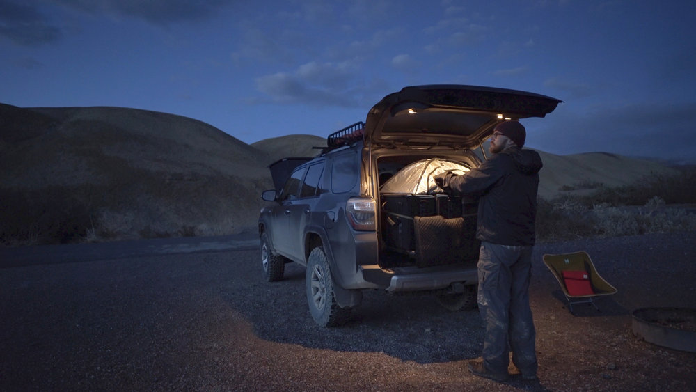 Loading 8x10 Film using a Harrison Film Changing Tent in the back of my Toyota 4Runner while camping in Death Valley.