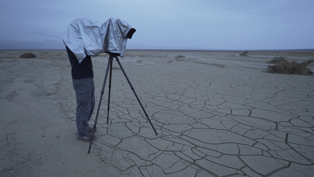 The Harrison Silver Classic Dark Cloth serves a double purpose, allowing you to fully operate your camera in the rain. In this photo, I am setting up my camera in a gentle rain before sunrise in Death Valley.