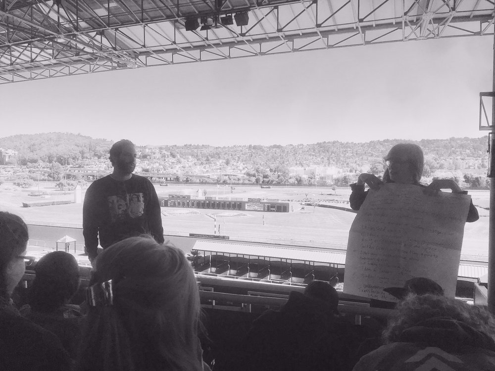 HOLDING CLASS IN THE GRANDSTANDS