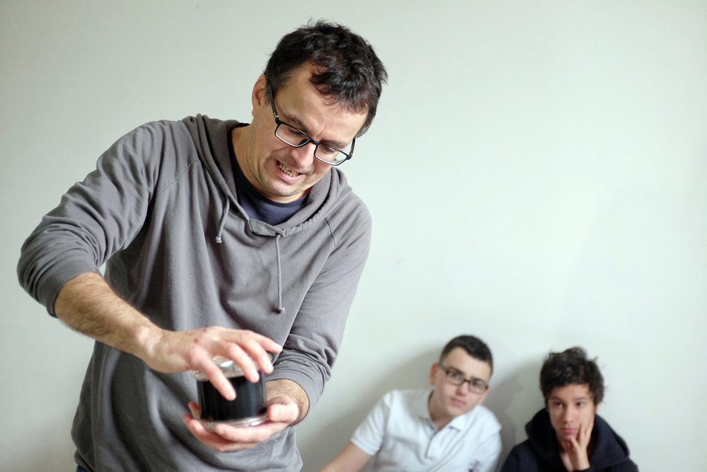 Photographer Ondřej Polák in his studio, teaching students how to work with film.