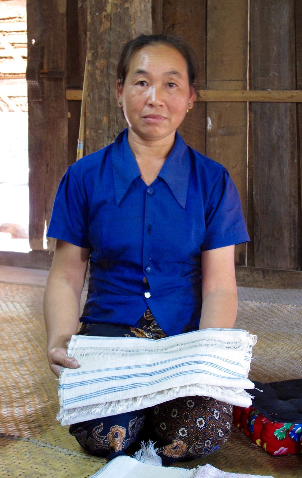 Panya with her delicately handwoven napkins