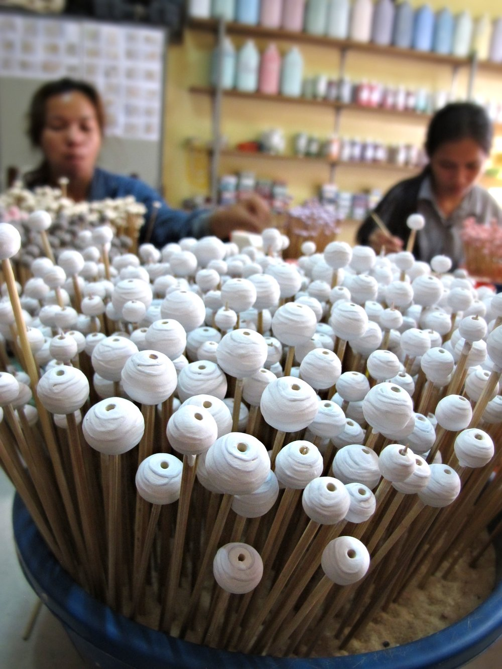 Like a field of flowers before blooming in full color, ceramic beads in the making at the Clay Cult studio workshop, Siem Reap, Cambodia