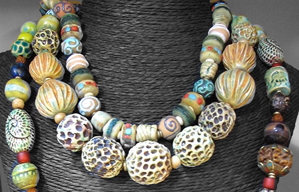 A string bouquet of one of a kind beads - big bulbous bespeckled - adorning each other to speak boldly in this statement necklace from Clay Cult, Siem Reap, Cambodia