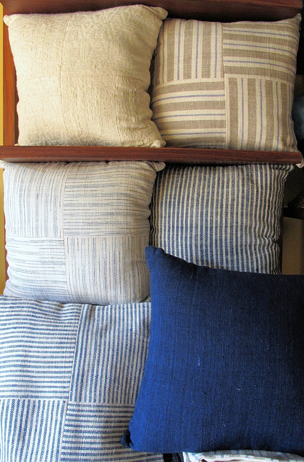 [Natural colors in peach yellow and indigo blue, in easy even stripes, cozy and soft squeezed together. Dreamy cushion covers handwoven by women of the Tai Leu ethnic group in Banayan village Laos. Also curated by Ma Te Sai.