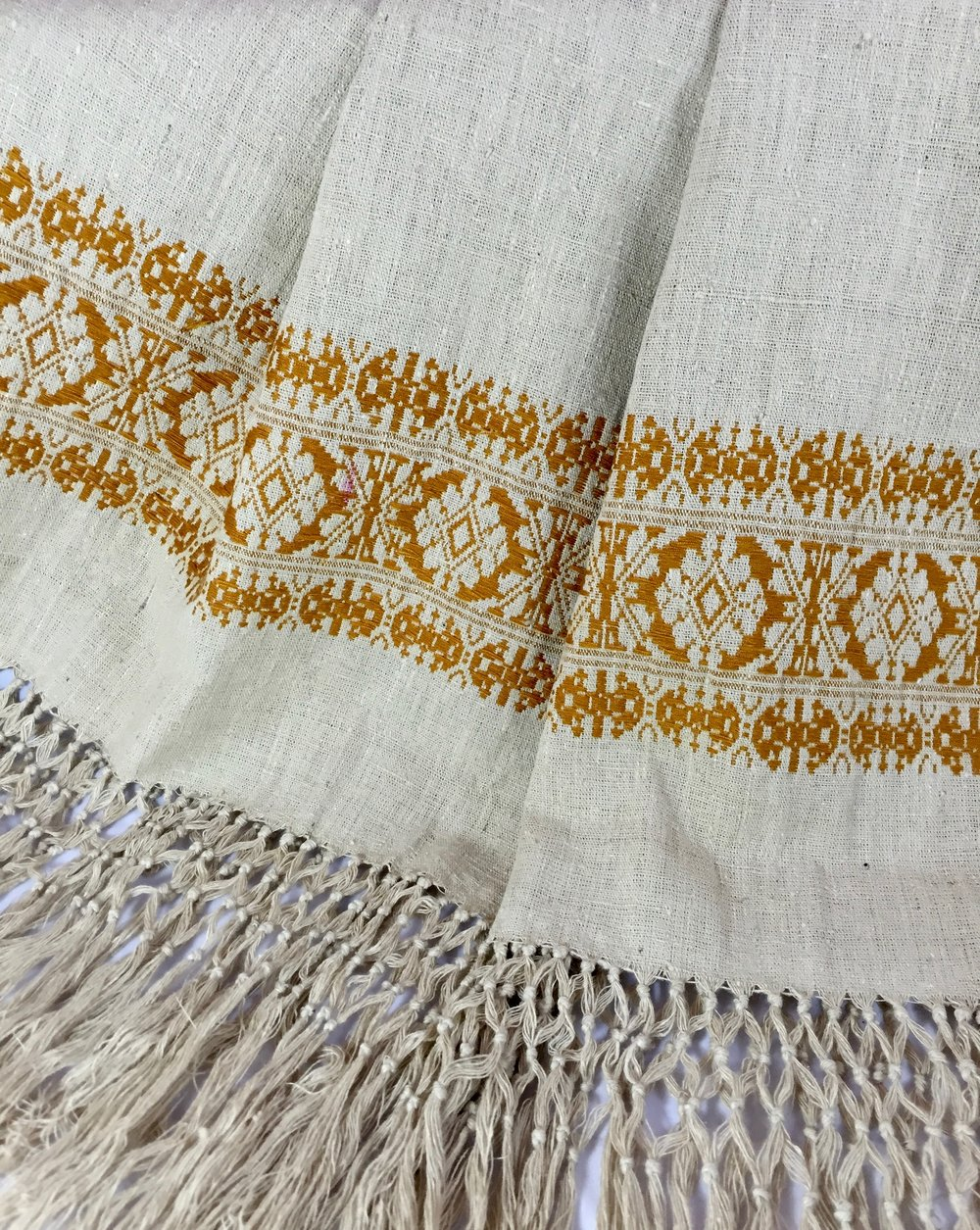 Detail of the handwoven stole that I lovingly acquired. Eri silk, from silkworms only found in Assam, India, is considered a 'peace silk'. The caterpillars live a full life cycle in the silk spinning process.