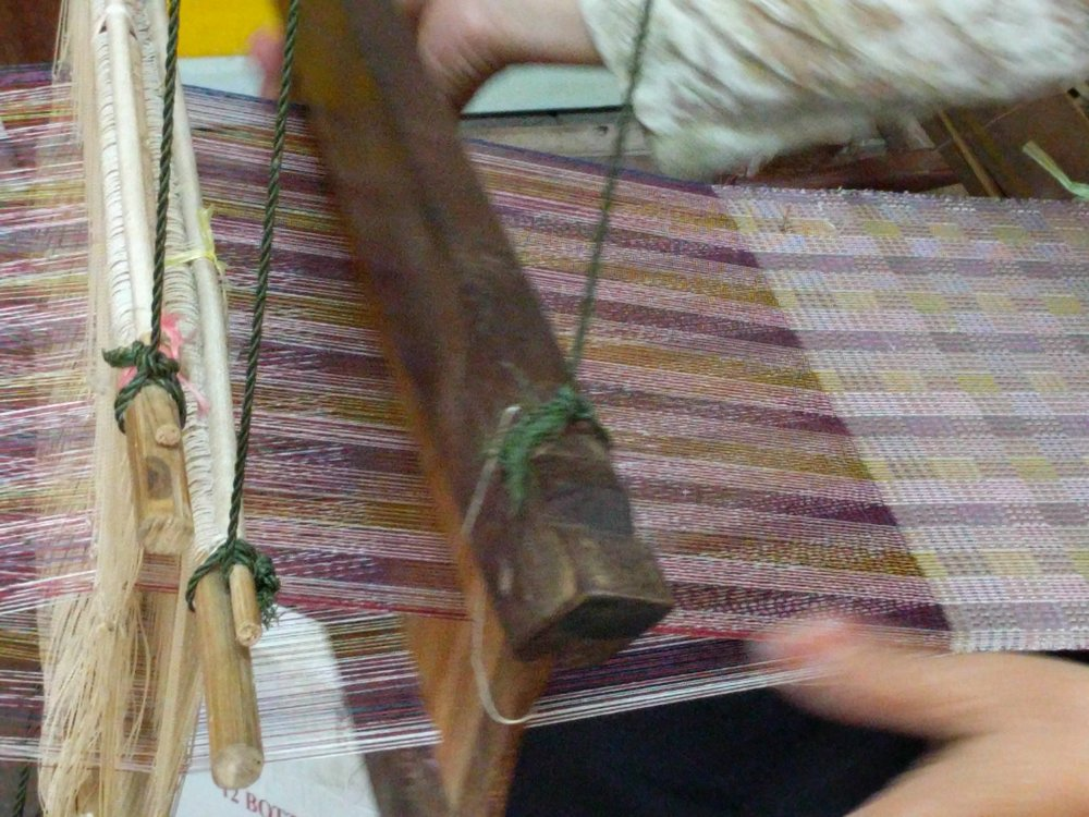 A master weaver at Khang, a center for fine silks, textile design, Lao fashion and traditional weaving in Luang Prabang, Laos.