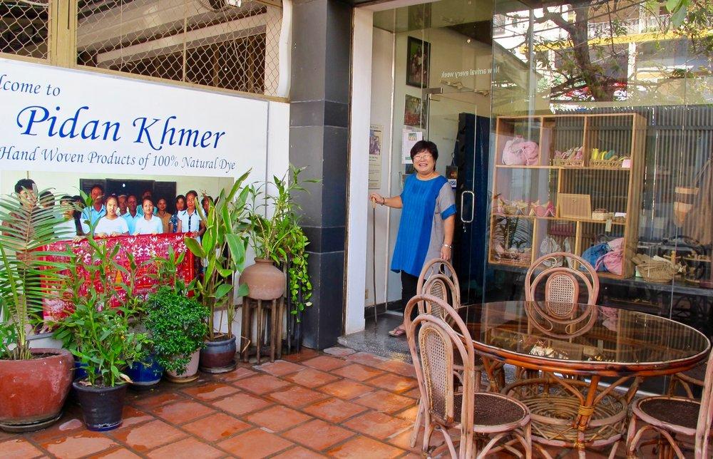 Harumi Sekiguchi in front of the Pidan Khmer / CYK shop in Phnom Penh