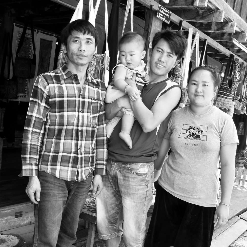 (February 2018)  I got to know the Vue family a little bit, who run the Hemp Fabric Hmong Shop in Luang Prabang, since I showed up at their shop on quite a few occasions. There's Tou (older brother), Xeng (younger brother), Lulu (wife of younger brother) and Vi, their infant son.  The first time I entered the shop I was approached by Xeng, the owner. He studied economics at university and two years ago decided to open his Hmong shop. It's clear he's dedicated to his Hmong family traditions and culture, sources directly from families from his village Nakhampheng and neighboring villages, and is doing what he can to preserve their unique traditions by sharing with others, and curious foreigners like me.  They all sew, too, making contemporary items from vintage designs. And they offer a wax-resist batik stamping class, which was great fun, then dyed in indigo the next day for pick up.  There are shops that are welcoming, that are free with their knowledge and generous with their time, and joyful at what they are doing. Not all places are like this. But this one most definitely was.