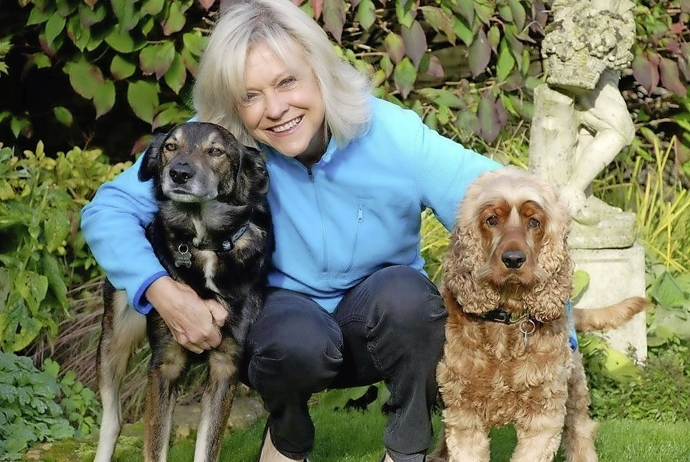 Sue pictured with her rescue dogs Batty and Charlie