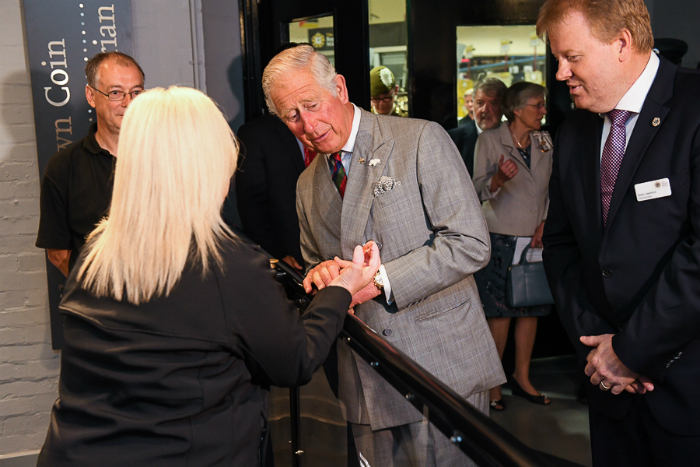 Prince Charles inspects his handy work at The Royal Mint