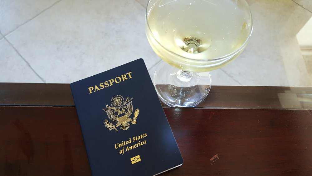 passport with champagne