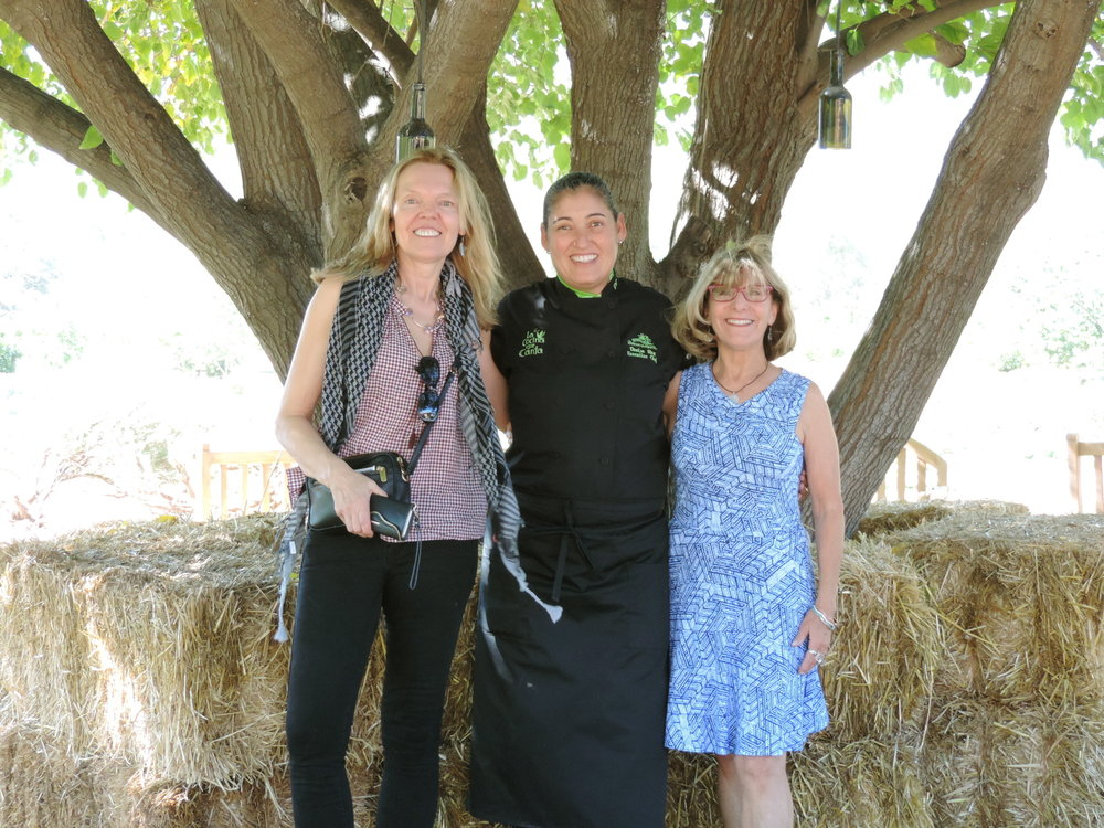 Joy and Angie with  Denise Roa , the Executive Chef of La Cocina Que Canta, under the tree of life - Rancho La Puerta.