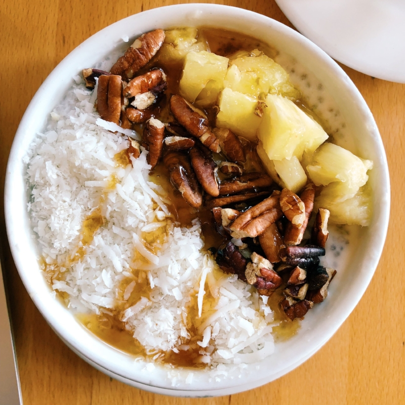 The coconut chia pudding bowl at The Green Corner with pineapple, pecans, shredded coconut and maple syrup
