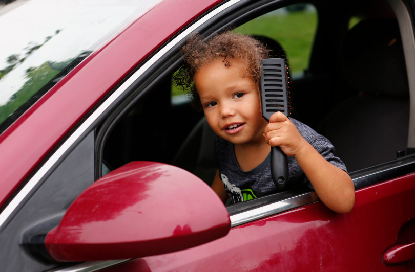 Amarion Parker, 2 , combs his hair in the car he lives in with his family in Gilroy, Calif., on Monday, August 14, 2017. His parents, Jennifer and Ashante Parker, couldn't make rent on their Modesto apartment after Ashante suffered an injury to his back. The family has lived out of the car for the past few months with their three kids. (Gary Reyes/ Bay Area News Group)