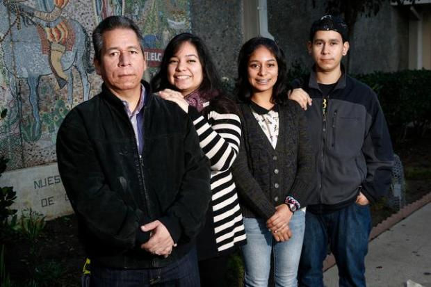 Ernesto Perez and his family in front of Our Lady of Guadalupe Church in San Jose, in 2014. Standing left to right is Ernesto Perez, daughters, Angela, Edith and son Max. (Gary Reyes/Bay Area News Group)