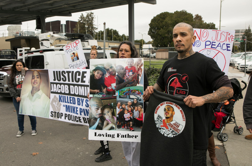 From right, Jesse Fernandez, brother, and Cindy Chavez, mother, protest the killing of their family member Jacob Dominguez by a San Jose police officer outside police headquarters in San Jose, California, on Wednesday, January 10, 2018. (LiPo Ching/Bay Area News Group)