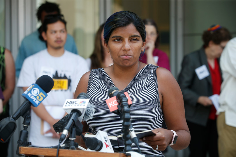 Sita Stukes of Women's March San Jose speaks in front of City Hall in San Jose, Calif., Monday, Aug. 6, 2018, at a rally over the the role of San Jose's independent police auditor. (Karl Mondon/Bay Area News Group)