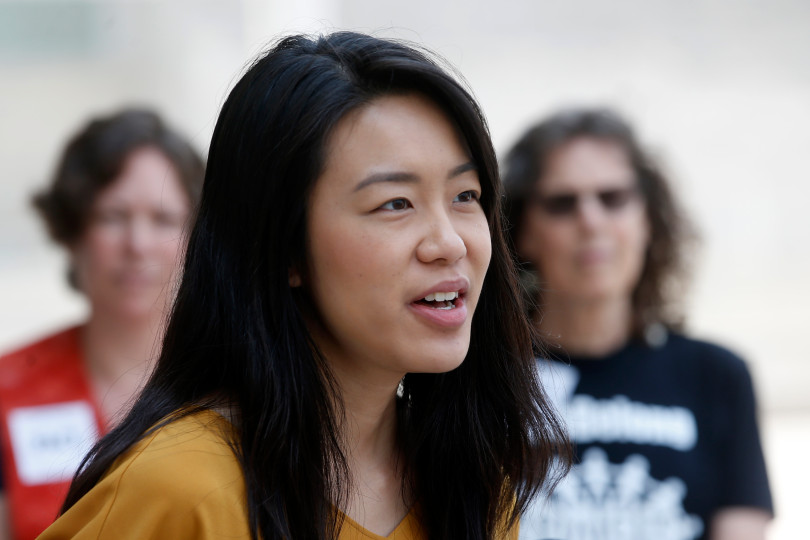 Giao Tran of the Asian Law Alliance speaks in front of City Hall in San Jose, Calif., Monday, Aug. 6, 2018, at a rally concerning the the role of San Jose's independent police auditor. (Karl Mondon/Bay Area News Group)