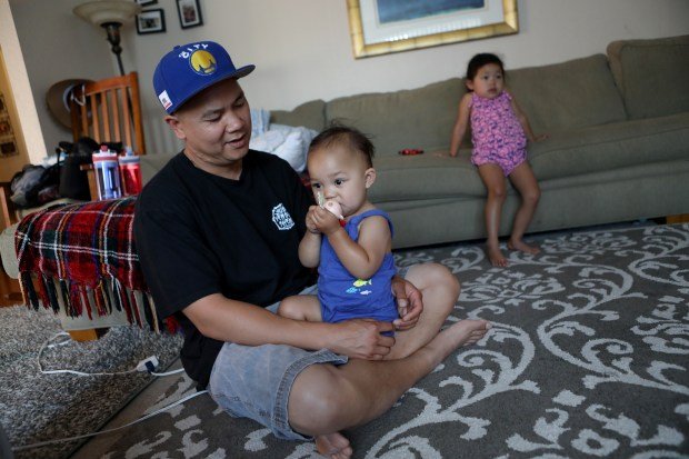 Phuoc Thang and daughters Audrina, 17 months, and Mia 3 spend time together at home in San Jose on Friday, July 20, 2018. Thang is among roughly 200 Cambodian & Vietnamese immigrants who, for the first time, are under threat of deportation for old crimes many of them committed as teenagers. (Anda Chu/Bay Area News Group)
