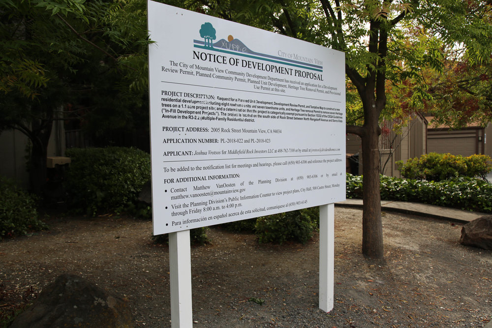 A sign sits in front of 2005 Rock Street, Mountain View, California, on Sunday, Sept. 30, 2018. It displays information on a new developmental proposal for the site. (Melanie Hogue/Peninsula Press)