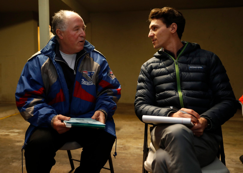 Mountain View, CA - DECEMBER 3: Daniel Saver, right, senior housing attorney with Community Legal Services in East Palo Alto, talks with resident Abel Salguero during their meeting in a carport at the rent controlled apartment building along Rock St. in Mountain View, Calif., on Monday, Dec. 3, 2018. They meet every week. Mountain View city officials are considering a developer's proposal to raze 20 rent-controlled, affordable apartments and replace them with 15 new, luxury town houses. (Nhat V. Meyer/Bay Area News Group)