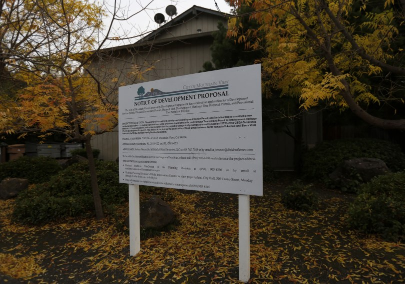 Mountain View, CA – DECEMBER 3: A sign announces a redevelopment proposal outside of the rent controlled apartment building along Rock St. in Mountain View, Calif., on Monday, Dec. 3, 2018. Mountain View city officials are considering a developer's proposal to raze 20 rent-controlled, affordable apartments and replace them with 15 new, luxury town houses. (Nhat V. Meyer/Bay Area News Group)