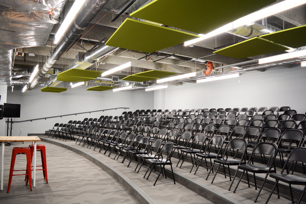 At times, larger lectures are scheduled for the school. Rather than pack in as many students as possible into a standard classroom, we created a room with tiered seating to house the larger crowds. When not in use as a lecture hall, students are able to work on projects with plenty of room for multiple groups in the room at one time; a truly multi-use space. Kestrel utilized the use of Armstrong SoundScapes Shapes to help keep noise levels down within the large, common areas.